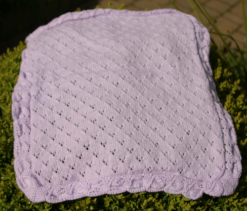 Purple knitted baby blanket