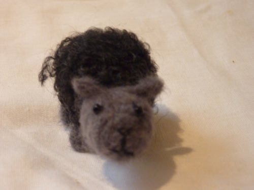 Small black felted sheep